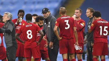 Hat mit dem FC Liverpool nichts zu verschenken: Meister-Coach Jürgen Klopp (M.)