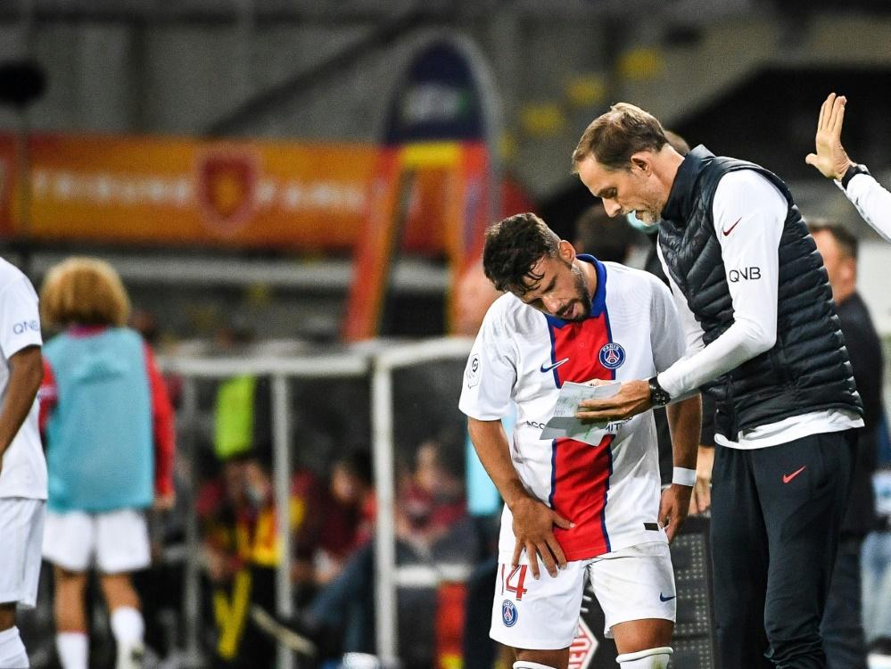 PSG-Verteidiger Juan Bernat (l.) und Trainer Thomas Tuchel