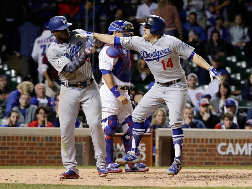Puig (li.) und Hernandez sorgten für das Aus der Cubs