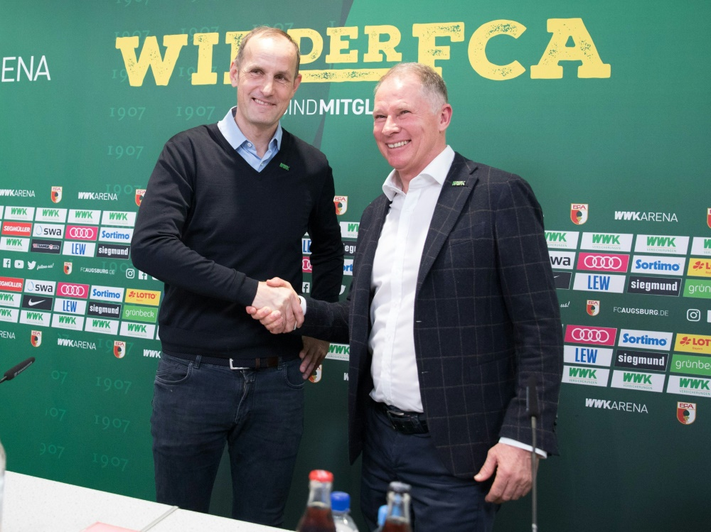 Reuter (r.) lobt Trainer Herrlich in den höchsten Tönen
